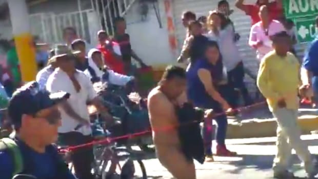 Man Forced To Walk Naked Through Mexican Town (Video) Promo Image