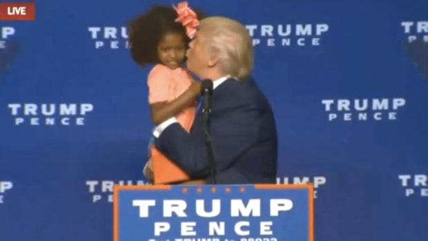 Trump Invites Girl On Stage, Gives Her Awkward Kiss (Video) Promo Image