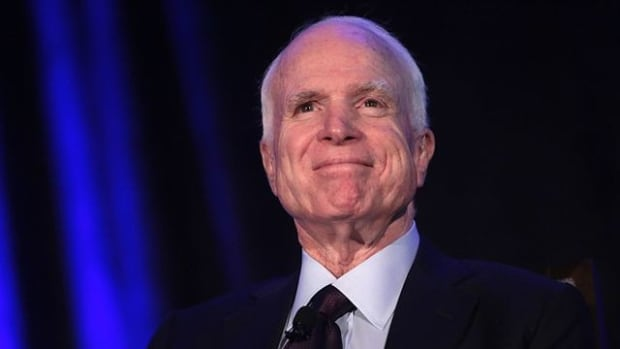 McCain Accuses Paul Of Working For Russia Promo Image