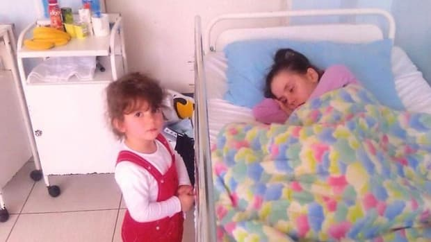 Mother Meets 7-Year-Old Daughter After Waking From Coma (Photo) Promo Image