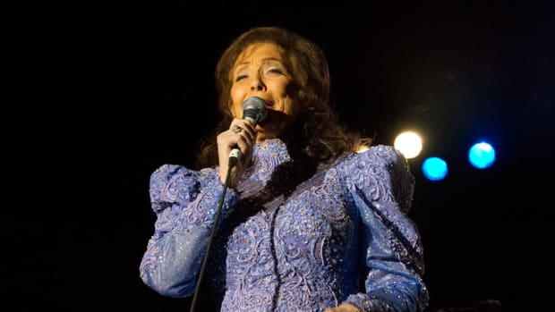 Country Music Legend Loretta Lynn Remains Hospitalized Promo Image