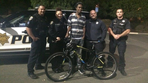Cop Surprises Carless Teen With Bike Promo Image