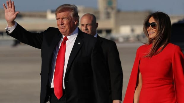 Why Won't Donald Trump Hold Melania's Hand? (Video) Promo Image