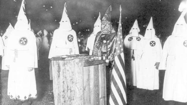 Art Professor Creates KKK Hoods With The American Flag (Photos) Promo Image