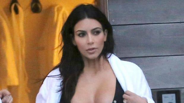 Kim Kardashian On Aaliyah Costume: 'We Don't See Color' (Photos) Promo Image