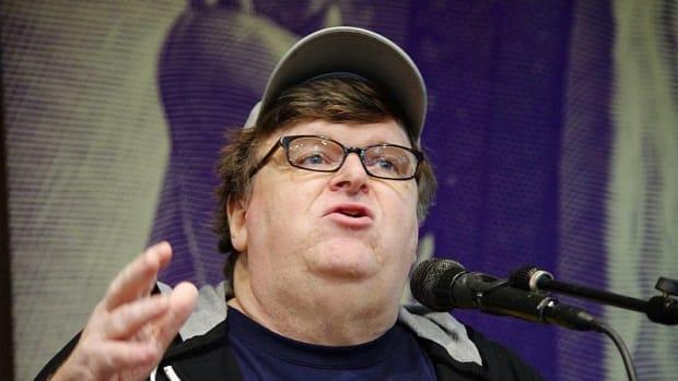 Michael Moore Slammed For Mar-A-Lago Shelter Suggestion Promo Image