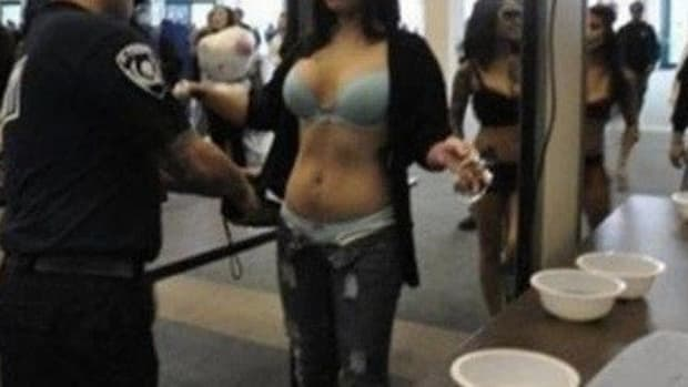 Officials Notice Something 'Weird' About Woman At TSA Checkpoint, Then Customs Agents See Her Breasts Promo Image