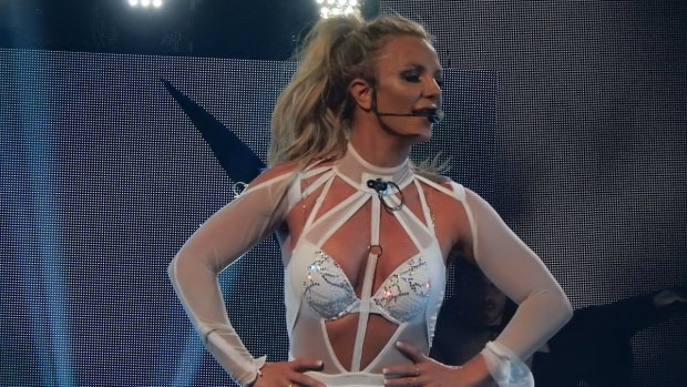 Britney Spears Shaken, Led Away After Man Rushes Stage (Video) Promo Image