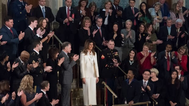 Melania Trump Wears White Amid All Black (Photos) Promo Image