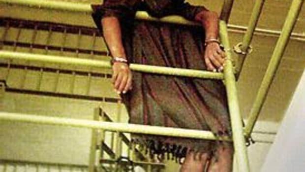 Abu Ghraib Prisoner Handcuffed to Railing