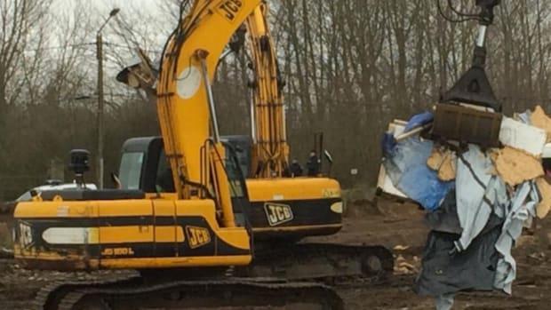 A bulldozer removes rubble