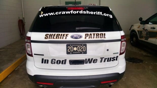 'In God We Trust' Added To Michigan County Police Cars Promo Image