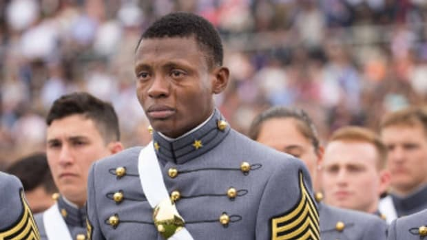 Photo Of Crying Soldier At Graduation Goes Viral (Photos) Promo Image