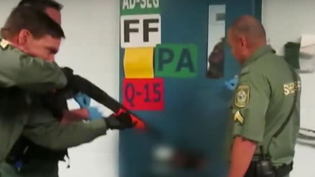 Cop Fires Concussion Round At Vet Inside Jail (Video) Promo Image