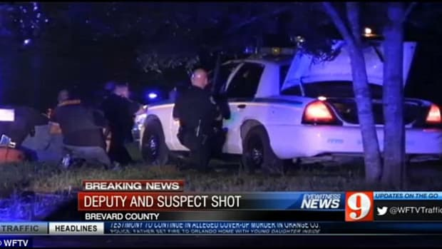 cop car at scene of shootout during arrest