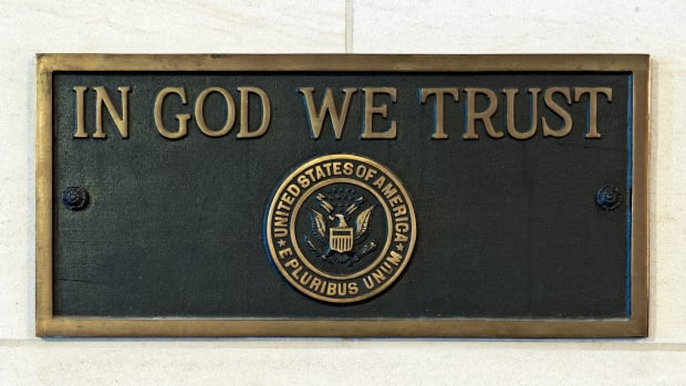 "A plaque from the US Capitol engraved with ""In God We Trust."""