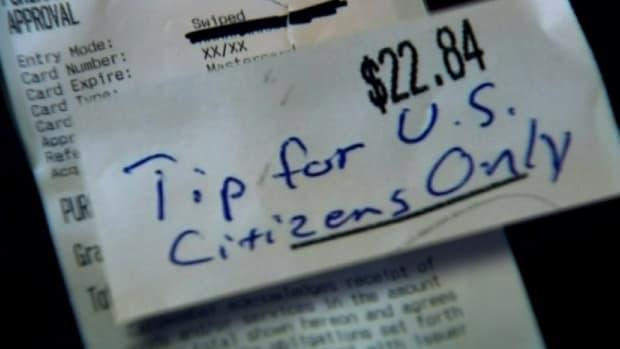 'Tip for U.S. Citizens Only' written on receipt at Thai restaurant