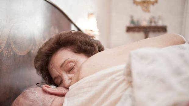 Elderly couple in bed (stock photo)