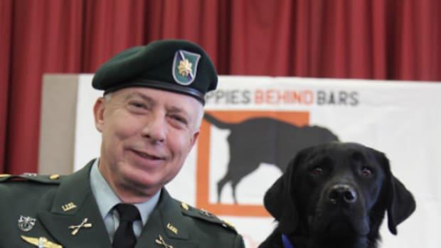 Major Diggs Brown with service dog Arthur