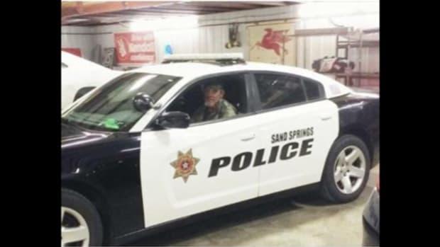 Gene Stretch behind the wheel of patrol car