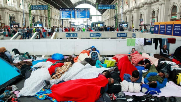 Refugees temporarily make camp at a Budapest train station.