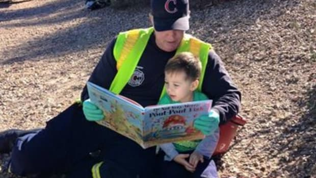 Firefighter Comforts Boy.