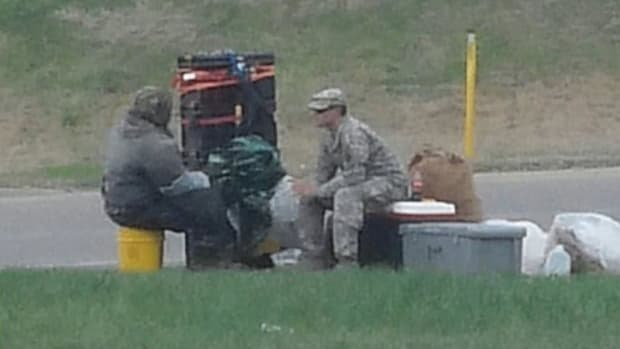 Soldier Pulls Car Over To Talk To Homeless Man Promo Image