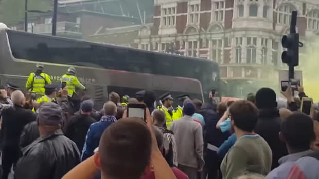 Soccer Fans Attack Opposing Team's Bus (Video) Promo Image