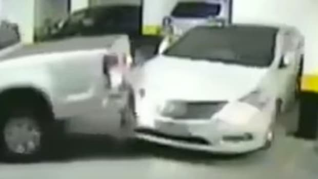 Driver Reacts Angrily To Double-Parked Car (Video) Promo Image