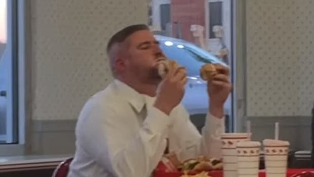 a man enjoying his In-N-Out meal