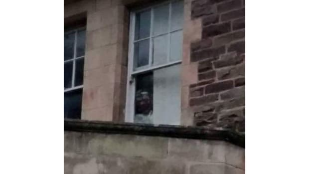 Can You Spot The Ghost's Face In This Asylum Window? Promo Image