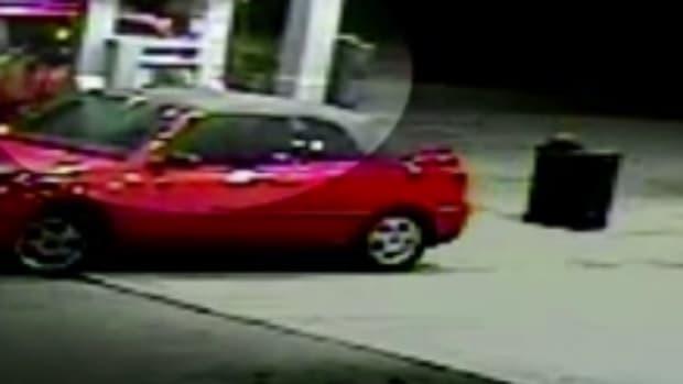 mom fending off carjacker at gas station