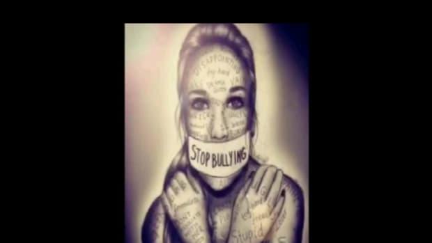 """Drawing of young woman who has tape over her mouth with """"Stop Bullying"""" written on it"""