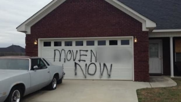 Here's What Someone Wrote On This Woman's Garage Door (Photos) Promo Image