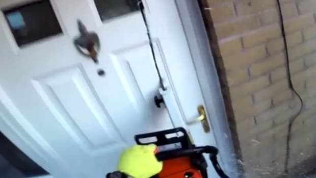 Police Use Chainsaw On Suspects' Front Door (Video) Promo Image
