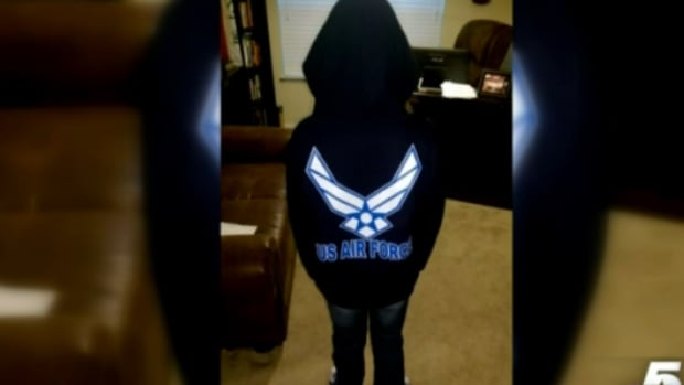 girl in U.S. Air Force sweatshirt