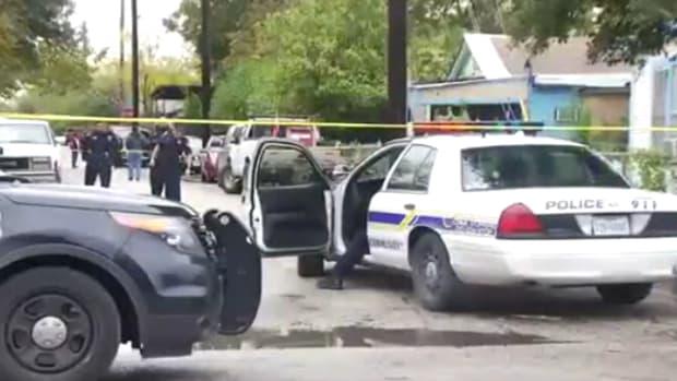 police at crime scene where San Antonio man shot his neighbor