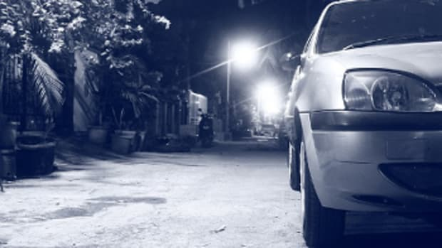 A car parked in an Indian city at night