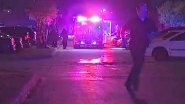 ambulance at the scene after Dallas police Sr. Cpl. Ed Lujan was run over