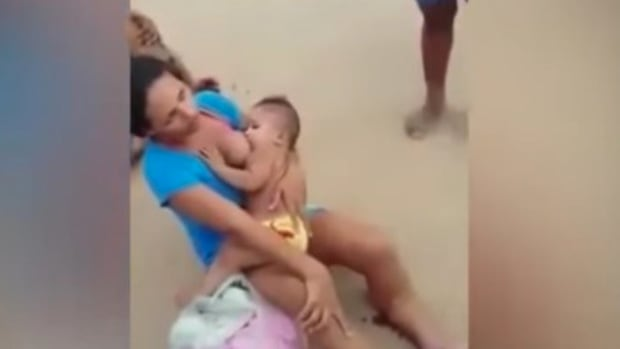 Woman Breastfeeds Child After Motorcycle Crash (Video) Promo Image