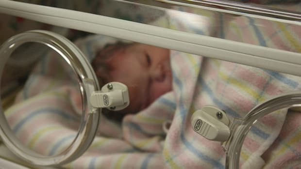 A baby in a maternity ward.