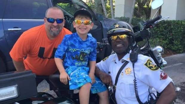 Deputy Jackson with boy and boy's father