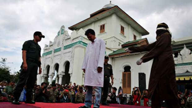 Wahyudi Saputra, 23, Being Caned For Indecency.
