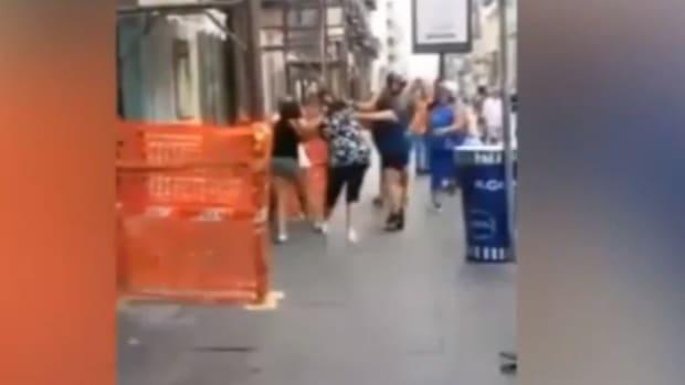 screenshot of women fighting on street