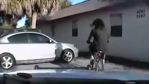 screenshot, Stephens riding a bike before Lin shot him