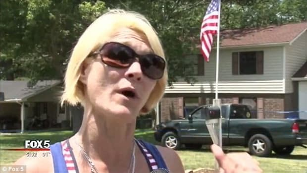 Stranger Attacks Woman With American Flag Promo Image
