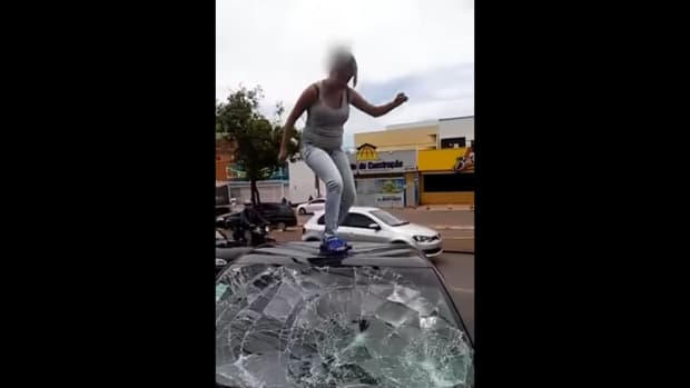 Woman Destroying Husband's Car.