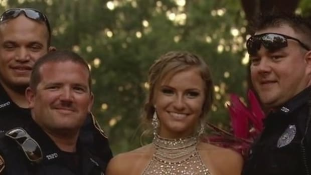 Officers Escort Fallen Colleague's Daughter To Prom Promo Image