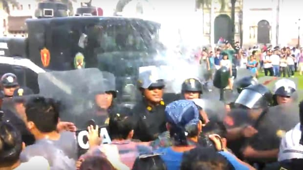 Lime, Peru, police using water cannons on protesters