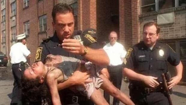 Woman Reunited With Cop Who Saved Her In 1998 (Photos) Promo Image